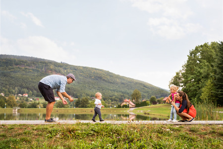 Happy family in nature in summer. Stock Photo - 87721538