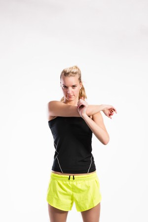 Attractive young fitness woman in black tank top. Studio shot. Stock Photo