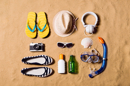 Summer vacation composition. Sandals, hat and other stuff agains