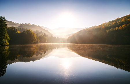Sunrise on the lake in autumn nature.