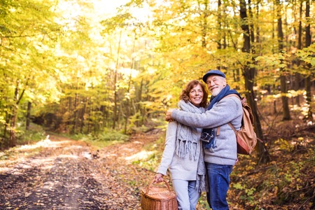 Senior couple on a walk in autumn forest. Reklamní fotografie - 89123052