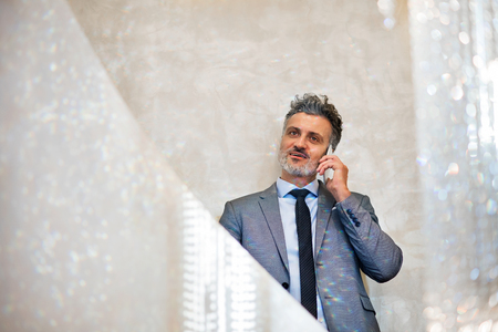 Businessman with smartphone making a phone call.