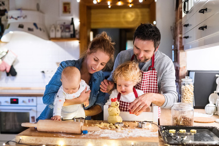 Young family making cookies at home. Stok Fotoğraf