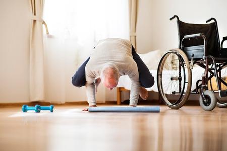 Senior man doing exercise at home.