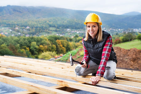 Young woman worker on the construction site.