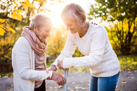 Senior women on a walk in autumn nature. Banco de Imagens