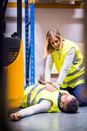 Warehouse workers after an accident in a warehouse. Stock Photo
