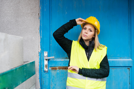 Woman worker standing outside a warehouse. Stock Photo - 91141778
