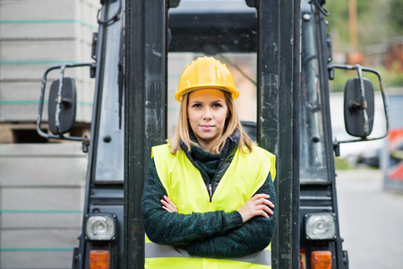 Woman forklift truck driver in an industrial area. Stock Photo - 97814197