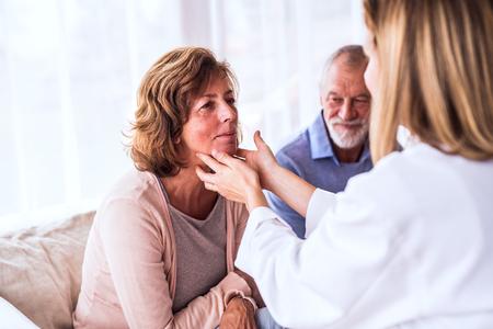 Female doctor examining a senior woman.