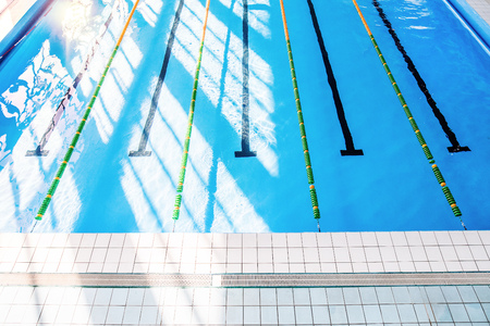 Lanes of an indoor public swimming pool. Stock Photo