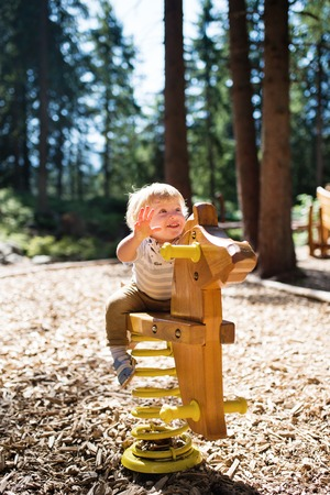 Cute little boy on the playground. Banque d'images