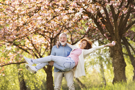 Senior couple in love outside in spring nature. Banque d'images