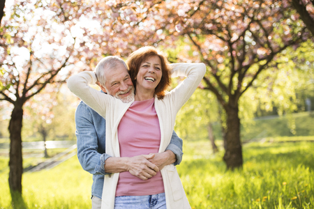 Beautiful senior couple in love outside in spring nature. Фото со стока - 93211345