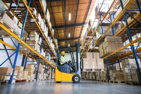 Warehouse man worker with forklift. Archivio Fotografico