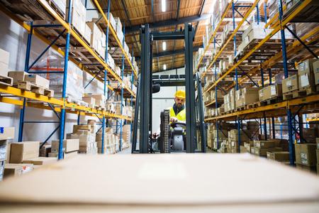 Warehouse man worker with forklift. Stok Fotoğraf