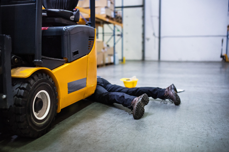 Warehouse worker after an accident in a warehouse. 스톡 콘텐츠