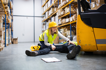 An injured worker after an accident in a warehouse. Stock Photo