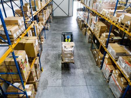Warehouse man worker with forklift. Reklamní fotografie