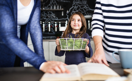A small girl with mother and grandmother at home. Stock Photo