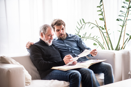 Hipster son and his senior father at home.