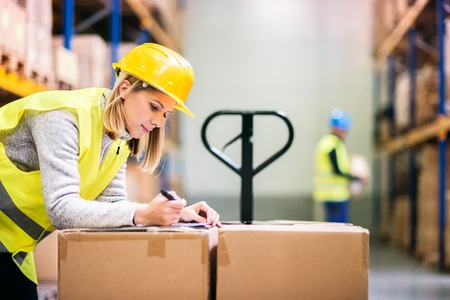 Young workers working in a warehouse.