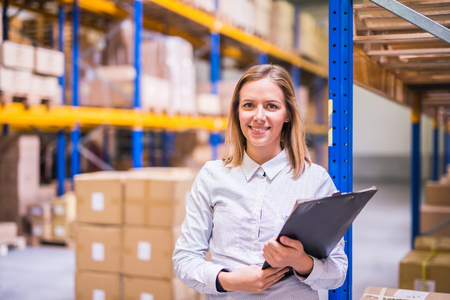 Portrait of a woman warehouse worker or supervisor. Stock Photo