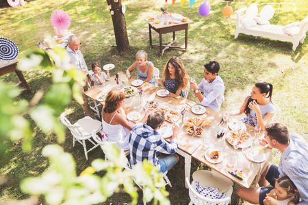 Family celebration or a garden party outside in the backyard. 免版税图像 - 96908804