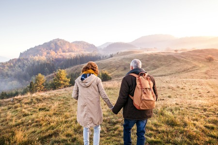 Senior couple on a walk in an autumn nature. Stock fotó