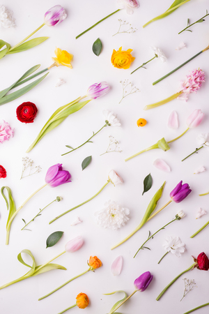 Easter and spring flat lay on a white background.