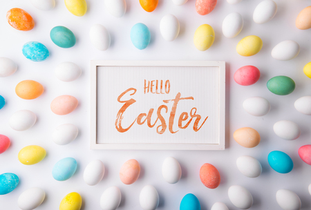 Hello Easter flat lay on a white background.