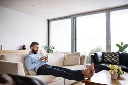 A man holding a smartphone. Smart home.