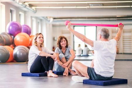 Senior physiotherapist working with a female patients. Stock Photo