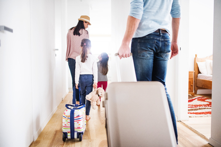 Young family with two children going on a holiday. Stockfoto