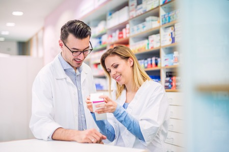 Two pharmacists working in a drugstore. Stock Photo