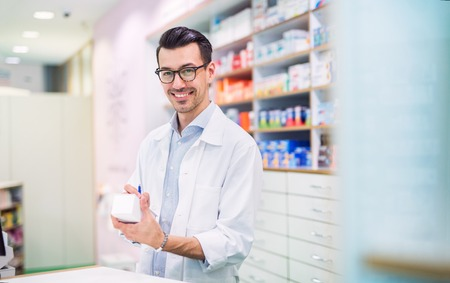 Portrait of a young friendly male pharmacist. 版權商用圖片