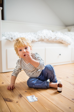 Toddler boy in a dangerous situation at home. Stock Photo - 100622964