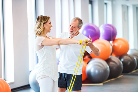 Senior male physiotherapist working with a female patient. Stock Photo - 100623059