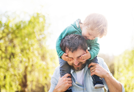 A father with his toddler son outside in spring nature. Stock fotó