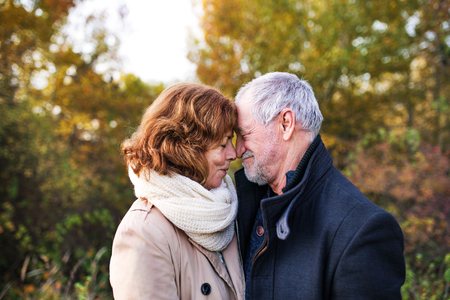 Senior couple in love in an autumn nature, touching noses. Stok Fotoğraf - 106460828