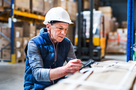 Portrait of a senior male warehouse worker or a supervisor. Stockfoto