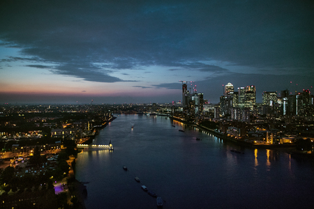 A dusk over a skyline of London with the river Thames.