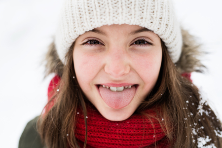 A small girl having fun in snow. Stock Photo