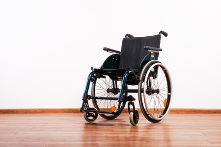 A wheelchair on a white background. Copy space.