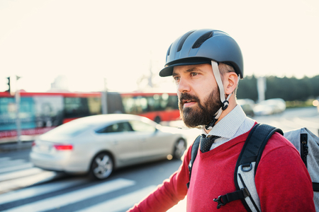 Hipster businessman commuter with bicycle traveling to work in city. Фото со стока - 116645292