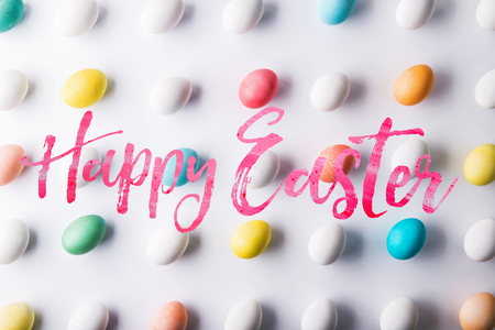 Happy Easter and flat lay on a white background.