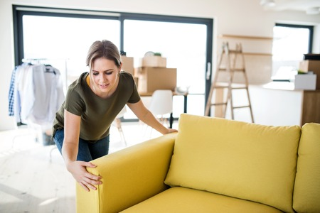 A young woman moving in new home.