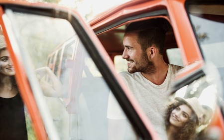 A young couple on a roadtrip through countryside. Stock Photo