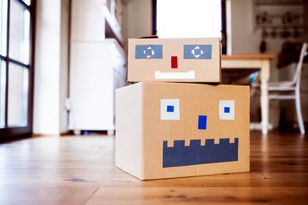 Cardboard monsters on the floor indoors, diy toy art and craft. Reklamní fotografie - 123048660