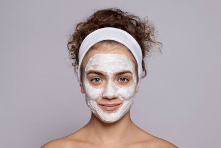 A portrait of a young woman cleaning face in a studio, beauty and skin care. Stock Photo - 124677193